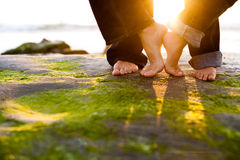 Füße am Sonnenuntergang Lizenzfreies Stockfoto