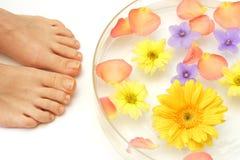 Füße und Blumen Lizenzfreie Stockbilder