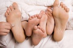 Füße und Feder Stockfotos