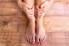 Füße und Hände Stockbild