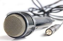 Führen Sie das Mikrofon Lizenzfreies Stockfoto