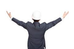 Führen Sie die Ansicht der Stellung zurück aus, die seine Arme hochhält Stockfotos