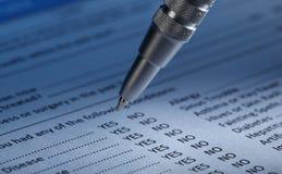 Füllendes Dokumenten-Formular Lizenzfreie Stockfotos