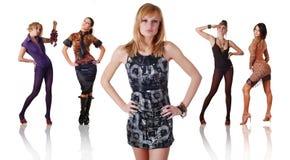Fünf Frauen in der unterschiedlichen Kleidung Lizenzfreies Stockfoto
