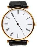 Fünf Minuten zu fünf Uhr auf Skala der Armbanduhr Lizenzfreies Stockbild