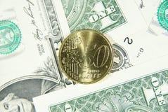 Fünfzig Eurocent und Dollar Stockfotografie