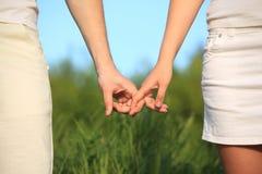 Für einander angehalten zu werden Hände, stockfotos
