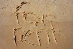 Für Miete im Sand Lizenzfreie Stockbilder