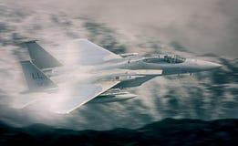 F15军事喷气式歼击机飞行 免版税库存照片
