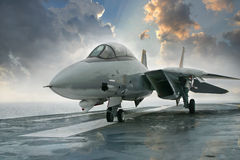 F-14 Tomcat jet fighter on carrier deck. An F-14 jet fighter sits beneath a dramatic sky on an aircraft carrier deck Stock Photography