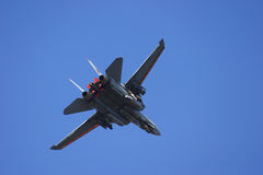 F-14 Tomcat in turn. Against a blue sky Stock Photo