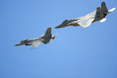 An F-15 and an F-16 do a flyby Royalty Free Stock Photography