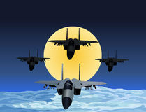 F-15 Fighter flying in formation at night.  Royalty Free Stock Image