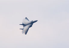 F-15 jet fighter with condensation clouds Royalty Free Stock Photography