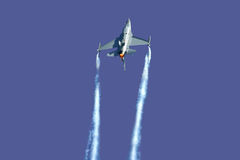 F-16 demo. F-16 flying its demo with smokewinders and full afterburner Stock Images