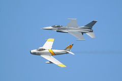 F-16 and F-86 airplanes in formation Royalty Free Stock Images