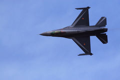 F-16 Fighting Falcon. Flying F-16 Fighting Falcon in the blue sky Stock Photography