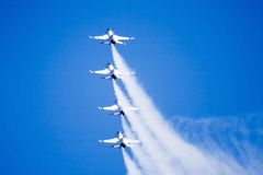 F-16 Fighting Falcons. Airforce Thunderbirds performing at airshow royalty free stock photo