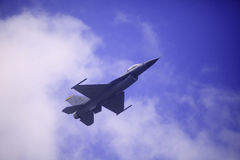 F 16 flies at Kaneohe Bay airshow. KANEOHE, HI, USA - SEPTEMBER 30, 2012. A U.S. Air Force F-16 Fighting Falcon performs maneuvers at the Kaneohe Bay Airshow in Royalty Free Stock Photo