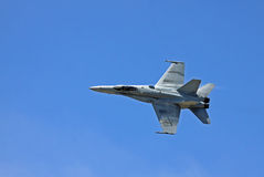 F-18 Hornet. USA Fa-18 Hornet fighter with vapor trail Royalty Free Stock Photography