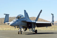 F/A 18 Hornet. The F/A-18 Hornet is a twin-engine supersonic, all-weather carrier-capable multirole fighter jet, designed to dogfight and attack ground targets ( Stock Photo