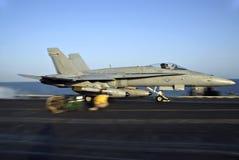 F-18 Hornet Catapult Shot. An F-18 Hornet rockets down the deck of an aircraft carrier stock photography