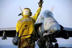 F-18 Hornet and Sailors Stock Photos