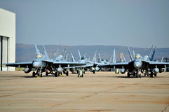 F/A-18 Hornets. USMC F/A-18 Hornets parked outside a Hangar stock image