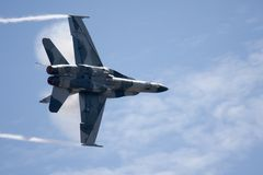 F-18 Super Hornet with Vapor. F-18 Super Hornet with smoke trail and vapor royalty free stock image