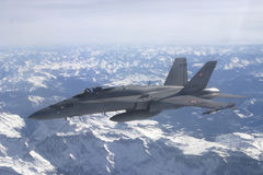 F/A-18C Hornet jet aircraft. Swiss Air Force F/A-18C Hornet jet aircraft over Swiss alps royalty free stock image