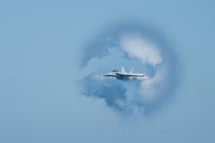 F/A-18F Super Hornet surrounded in vapor cone Royalty Free Stock Image