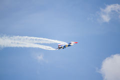 F16. Aerobatic aircraft flying in airshow exhibition Stock Photos