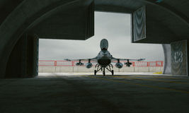 F 16 , american military fighter plane. Military base, hangar, bunker.  Royalty Free Stock Photography