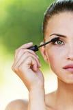 färgögonfranser vänder half kvinnor mot Arkivfoton