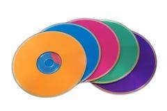 färgrika disks många multimedior royaltyfri bild