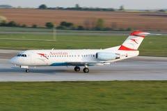 F70 Austrian. PRAGUE - APRIL 23: F70 Austrian lands PRG in Prague, Czech Republic on April 23, 2014. Austiran Airlines is the national flag carrier airline of Stock Photography