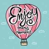 Enjoy every moment lettering word on pink hot air balloon cartoon illustration doodle style. Enjoy every moment lettering word on pink hot air balloon cartoon stock illustration