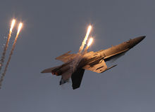F-18 on back with flares Royalty Free Stock Photography
