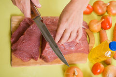 F cook hands cutting beef Stock Image