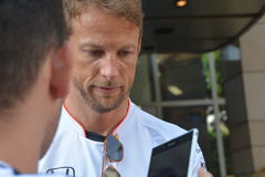 F1 Driver Jenson Button. Is among his fans and giving autographs on July 24, 2016 in Budapest, Hungary Stock Photos