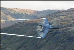 F-15e. F-15 eagle flying low through welsh valleys Stock Images