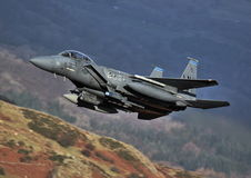 F15-E. An F-15E Strike Eagle conducting a low level sortie in the mountain range of North Wales (UK royalty free stock photography