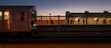 F express train coming through Smith & 9th St station. Royalty Free Stock Image