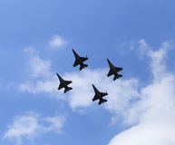 F16 falcon fighter jet flying on blue sky Royalty Free Stock Images