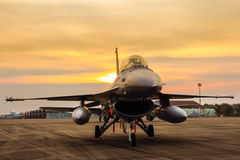 F16 falcon fighter jet on sunset  background. F16 falcon fighter jet in the base on sunset  background Stock Images