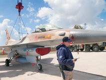 F-16 fighter at an exhibition attended by a crew member Stock Images