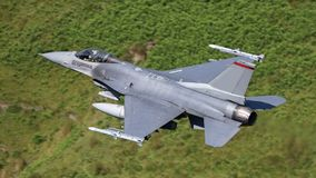 F16 fighter jet aircraft. USAF F16 military fighter jet aircraft in flight at apx 600 mph stock image