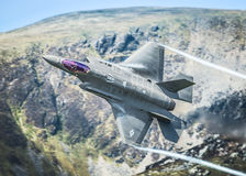 F35 fighter jet. Lockheed Martin USAF F-35A / F35 Lightning II fighter jet first time low level in the Mach Loop this week 2nd May 2017 Royalty Free Stock Image