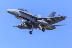 F18 fighter jet. F18 of the Spanish air force jet fighter approaching to land under blue skies Royalty Free Stock Images