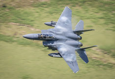 F15 fighter jet. United States Air Force F15 / F15E fighter jet aircraft making a low level high G pass in the Mach Loop, Wales.nn Stock Images